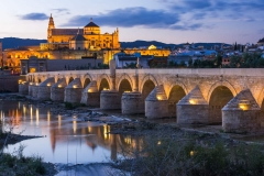 Cordoba, Spain view of the Roman Bridge and Mosque-Cathedral at twilight